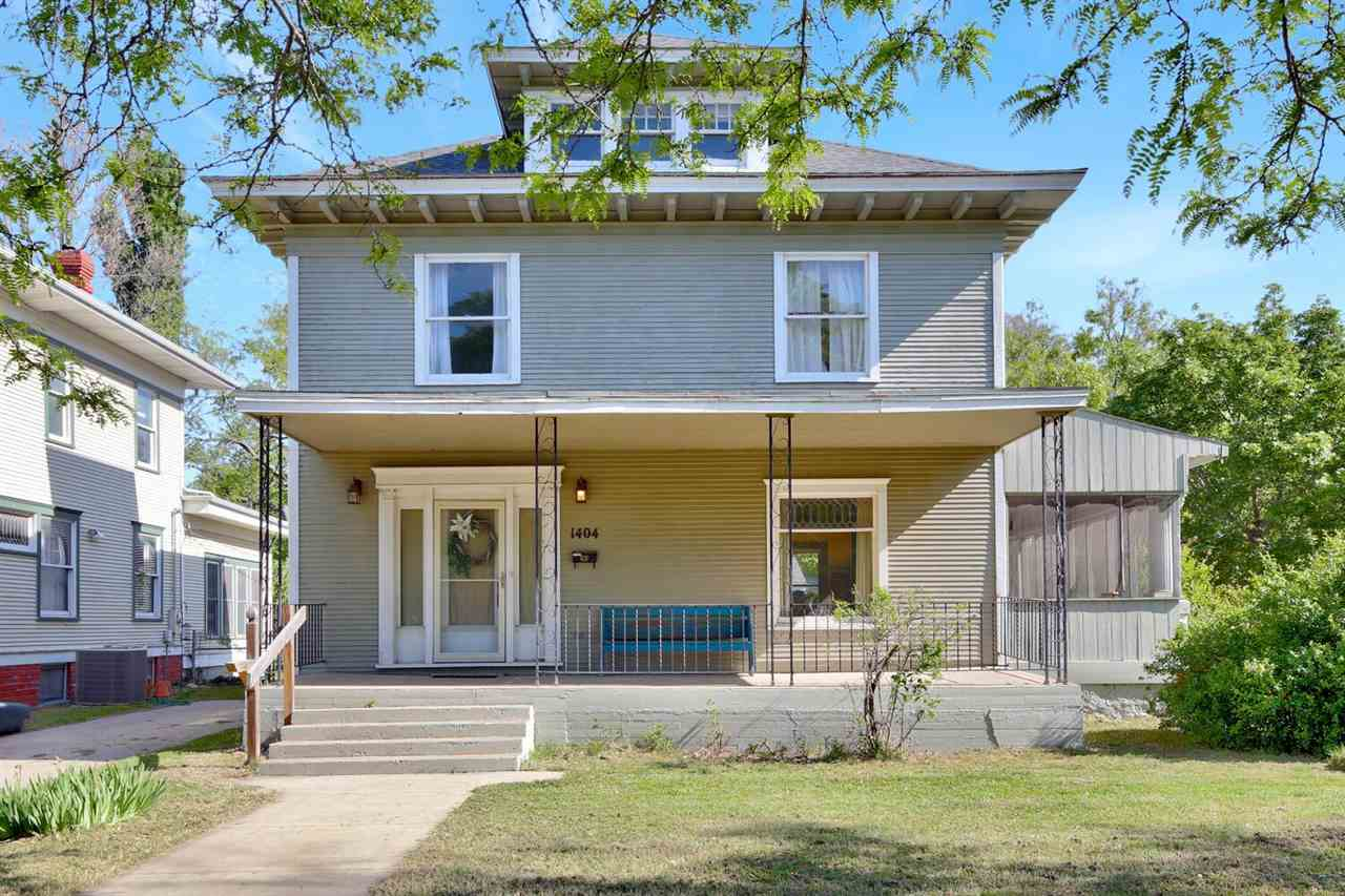 This two-story, turn-of-the-century home near Friends University is a rare find. It combines old world charm and many original finishes with a number of updated features in the last 10 years. These updates include roof, electric, plumbing, water line, HVAC, bathrooms, and kitchen. The home is full of character with original quarter sawn oak woodwork. Special attributes in this home that are not characteristic in many older homes of this grandeur are the two full baths on the upper level, laundry hookups near the bedrooms, a half-bath on the main floor, and a large walk-in pantry. An added bonus is the finished attic space, giving the home over 2300 above ground square feet, and the screened-in porch. The corner lot, detached single-car garage, new privacy fencing, and many trees add to the attractiveness of this property. Don't miss your opportunity to own a piece of history on one of the most desirable streets in the city.