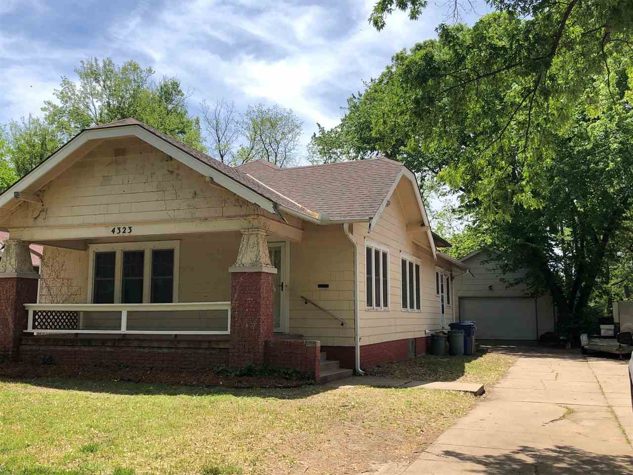 Bungalow in College Hill area with great space, Large rooms, Original hardwood floors.  Needs some T