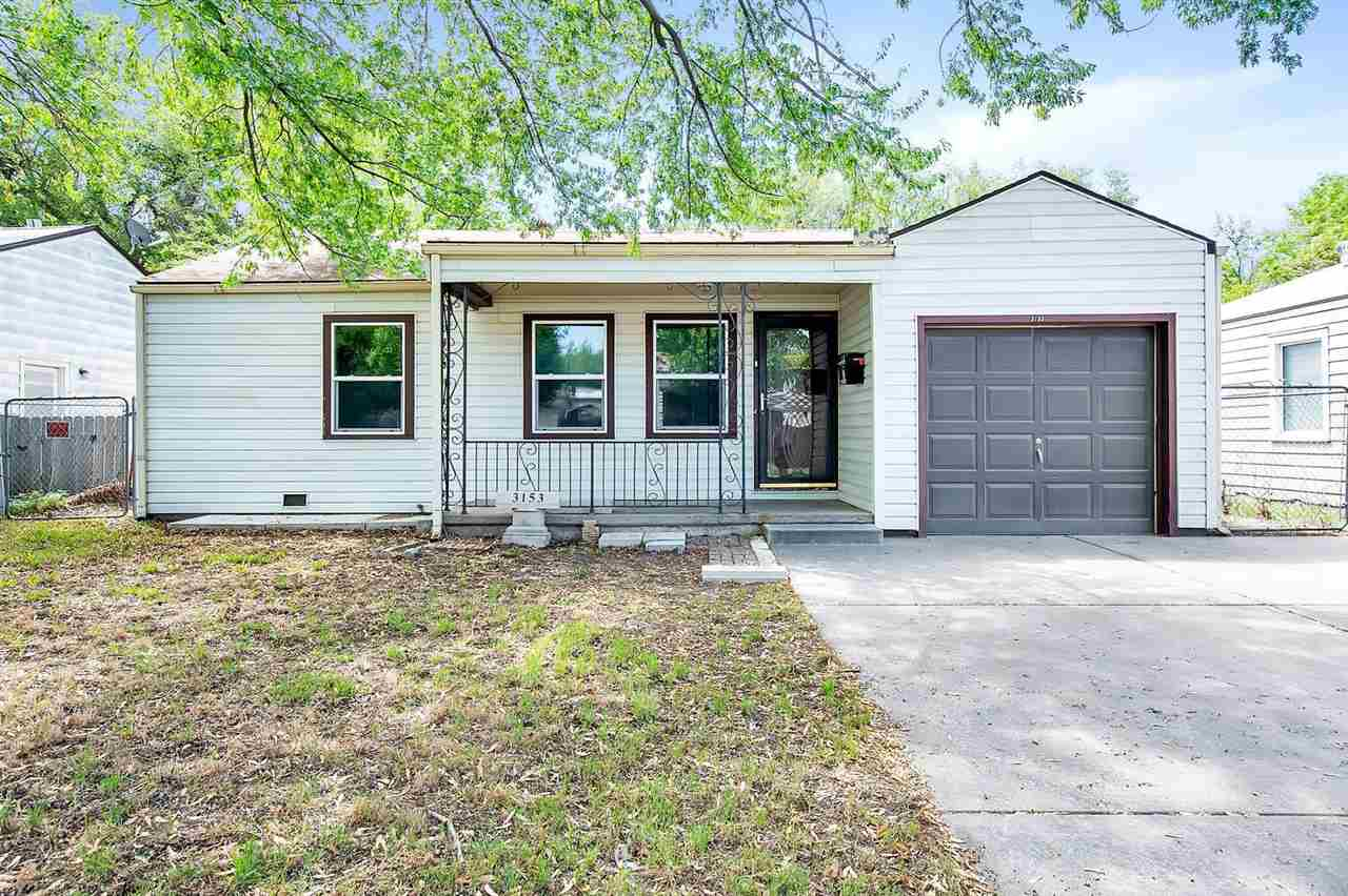 Darling three bedroom home near Newman and Friends University.  Rejuvenated the original hard wood floors, fresh paint, move in ready.  Updates throughout including faux wood levelor blinds, 2 year old dishwasher, 2 year old glass top stove, new ceiling fans.  HVAC system has been tested and inspected, a new condenser unit installed.