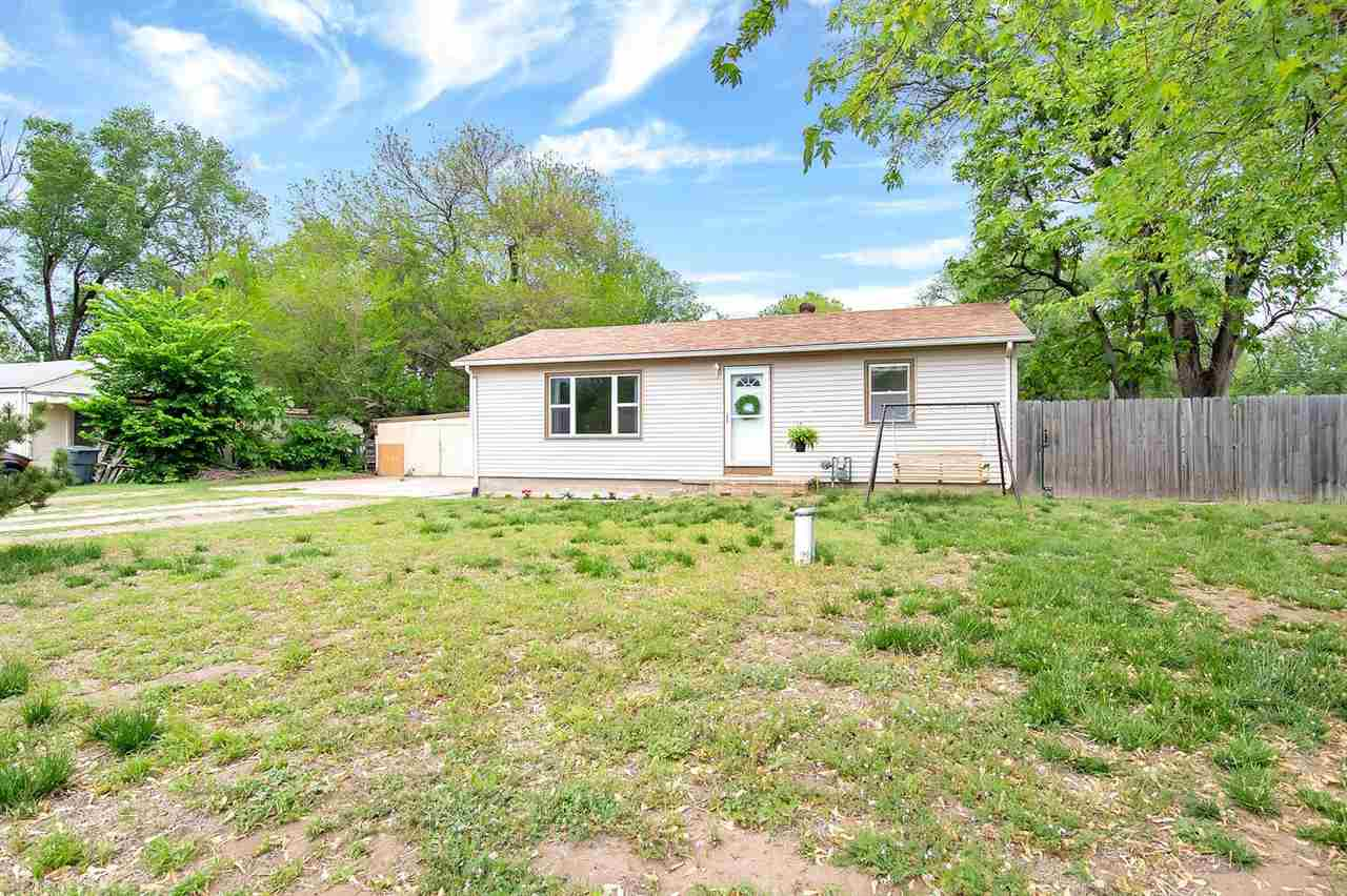 This charming ranch, sitting on a 0.35 acre lot, is ready to welcome you home. The large and bright