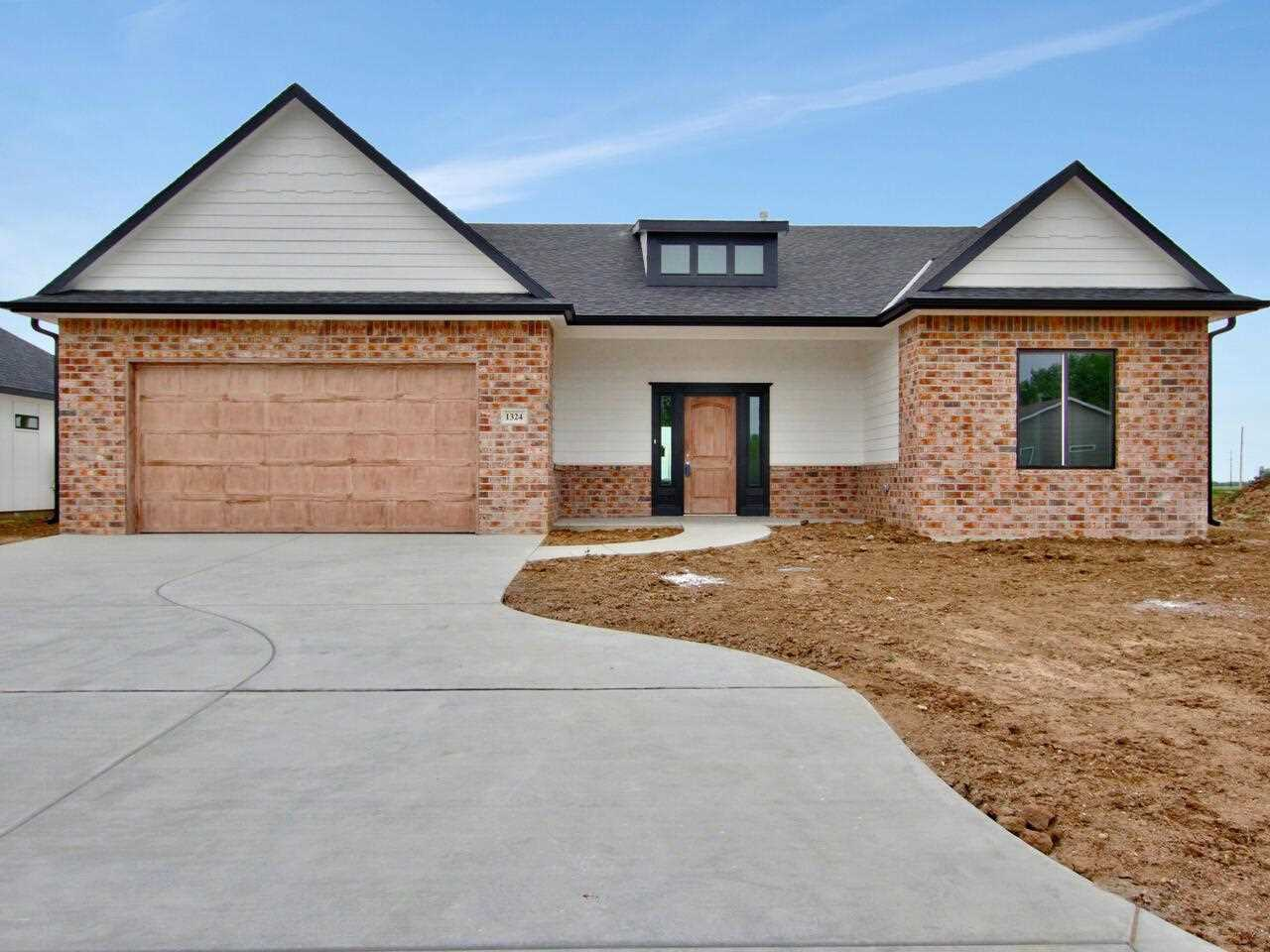 Beautiful new constructed home in Garden Plain Kansas. *NO SPECIALS* Slab floor plan with a large wa