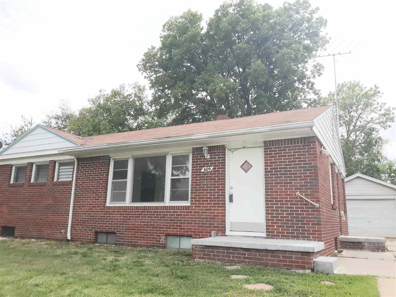Great brick ranch with detached 1 car garage and full basement with finished room (no egress). Wood floors, kitchen appliances stay, large backyard, and convenient access to Kellogg for easy commute! This home has been a rental and most recently obtained $760.00/month for rent. The water heater was replaced in December 2019. Heat and air are only a few years old. Transferable warranty on the basement I-beams. about 12 years ago the back exterior was re-bricked. Excellent investment property or first time home buyer opportunity! Room sizes and basement finished square footage are estimates.