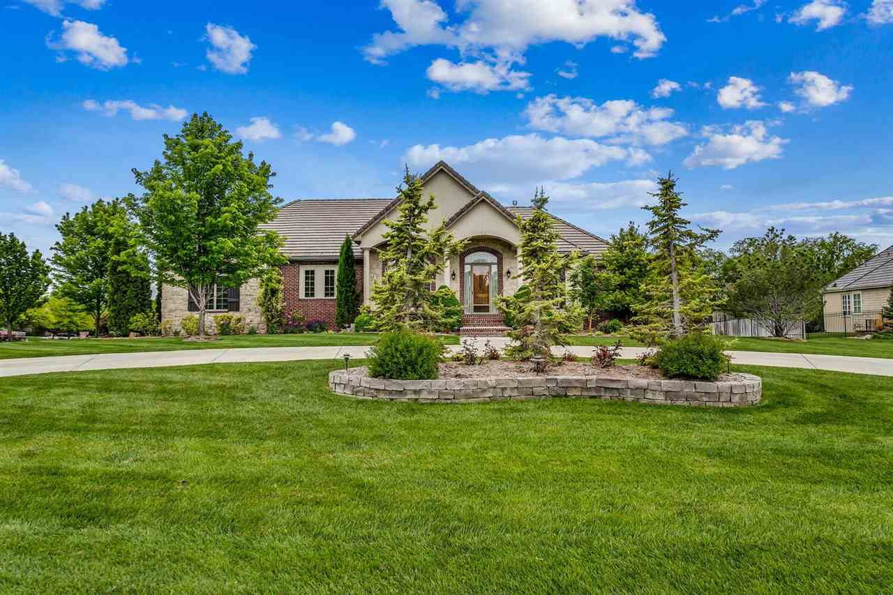 Welcome home to this sprawling ranch with front circle drive nested on a .79 acre lot in the desirab