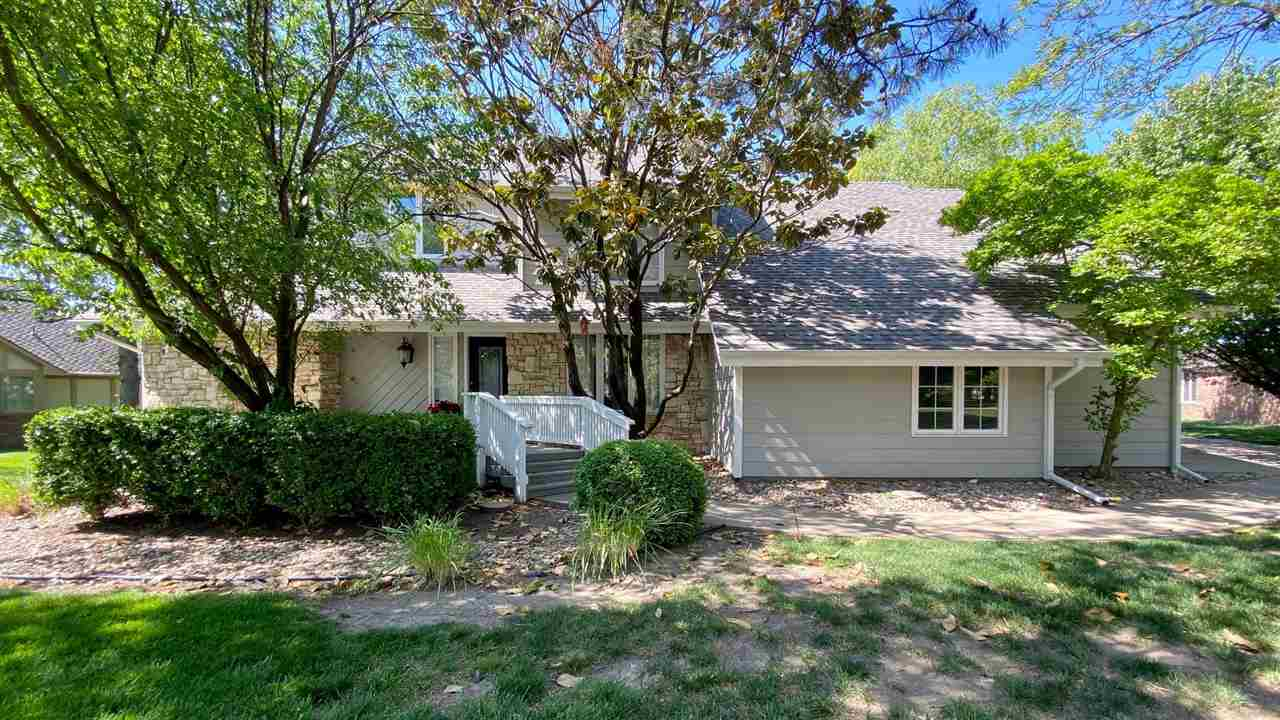 You will love coming home to this beautifully updated 1 1/2 story situated on a mature landscaped lo