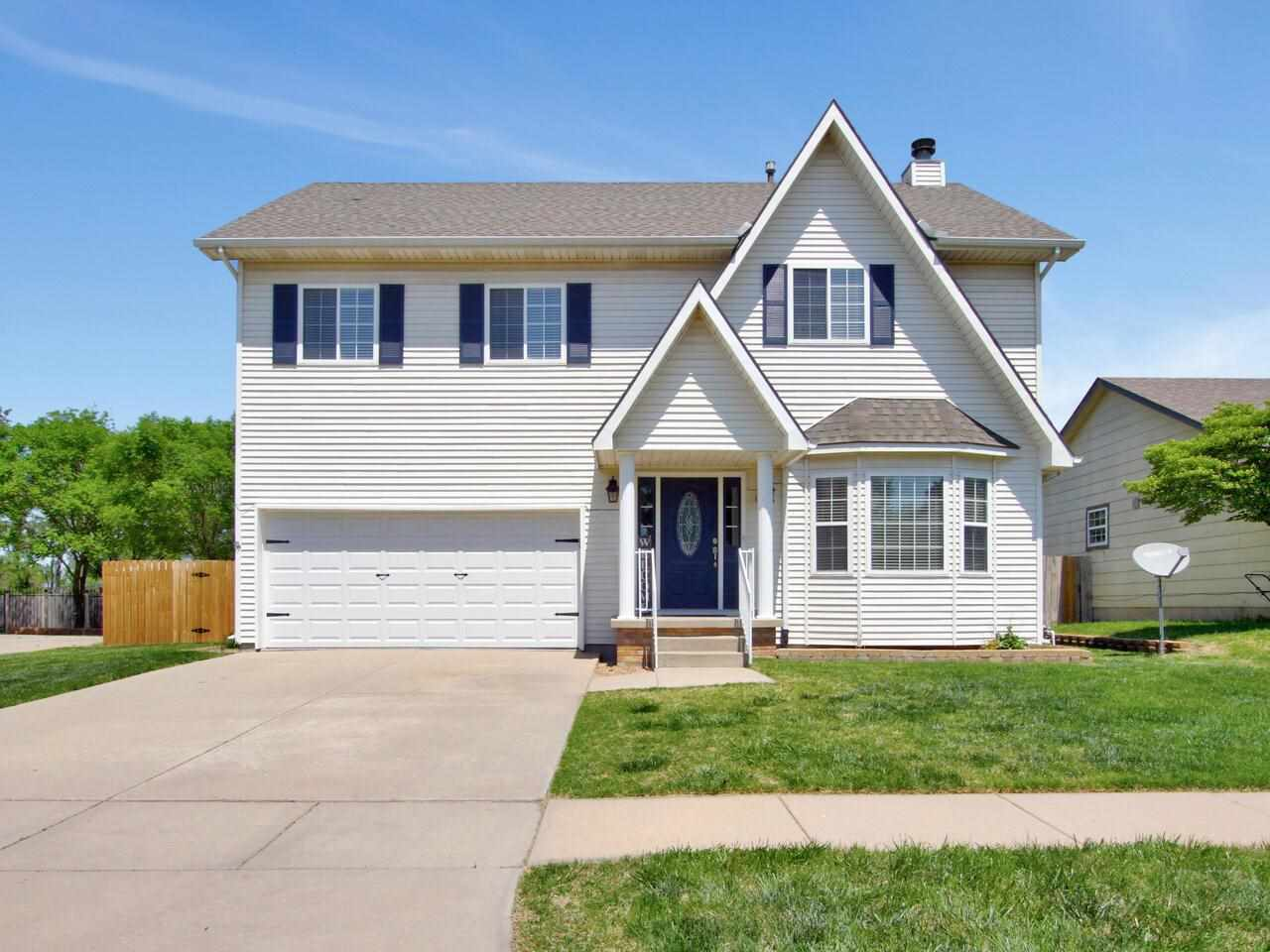 Beautiful two story home in SE Wichita with Derby schools!! As you enter through the front door you