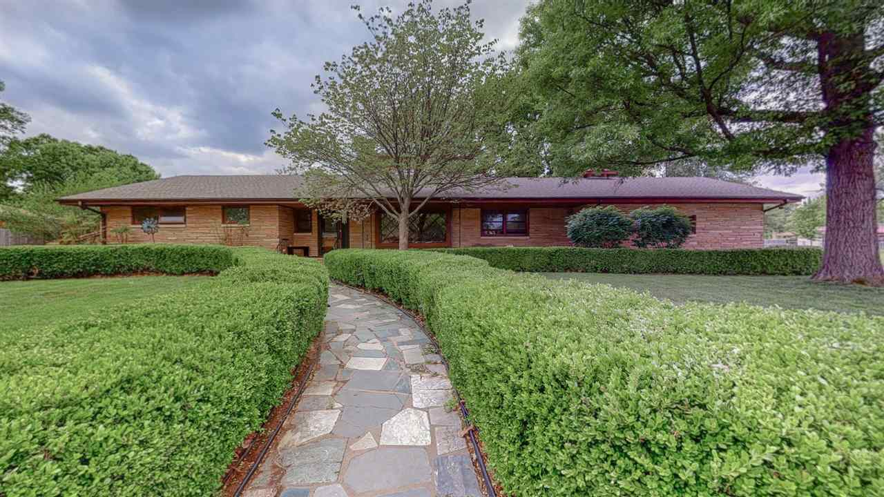 This is an awesome rambling ranch located on a corner lot and all brick. This home has so many updat