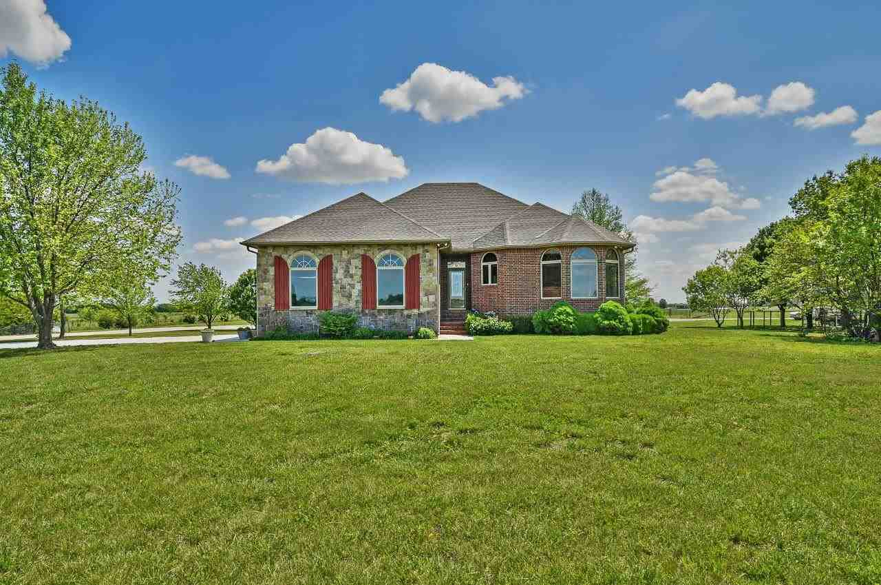 You won't want to  miss this beautiful custom-built home on paved road with 27 acres just south of C