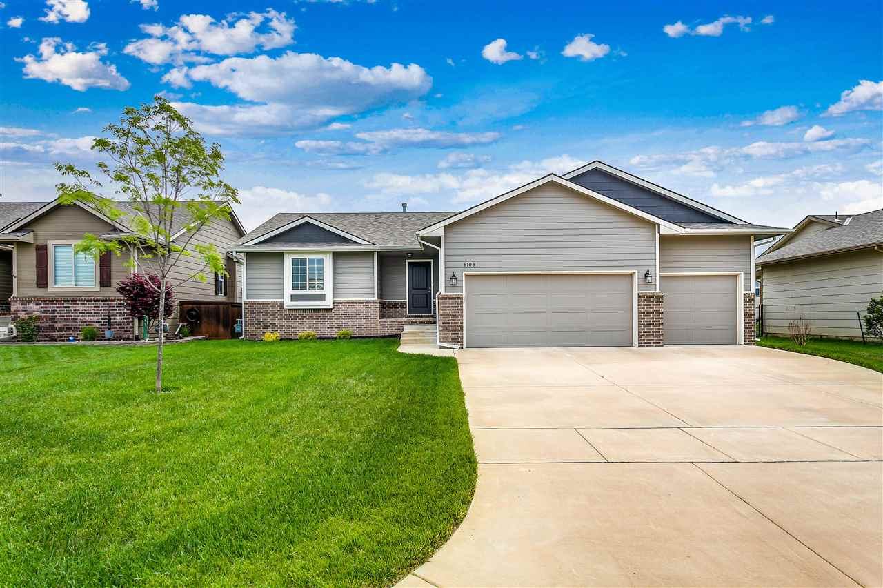 4 bedroom, 3 bath ranch home has an open floor-plan with Large kitchen & Island overlooking the Grea