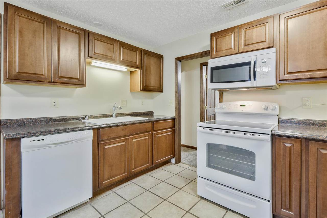 Perfect Starter home or Rental 2-BEDROOM 1-Bath 1-Car Garage, ZERO ENTRY, FENCED YARD, ALL APPLIANCE