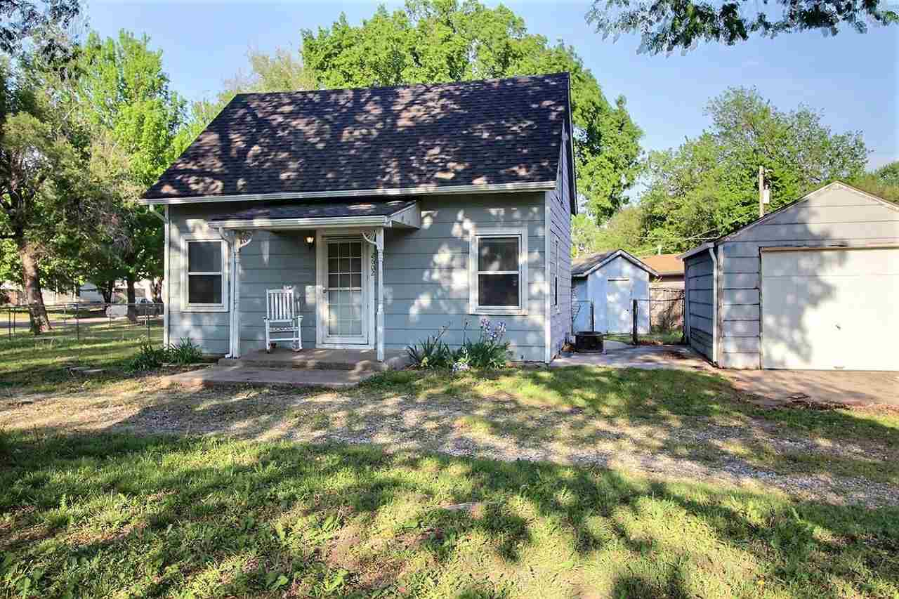 Charming investment opportunity! Cute two bed, one bath home sits on huge corner lot with mature sha