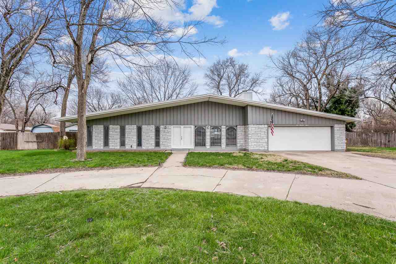 Remodeled Ranch in a Convenient Location on a 1/2 acre lot!  Gorgeous Circle drive with majestic tre