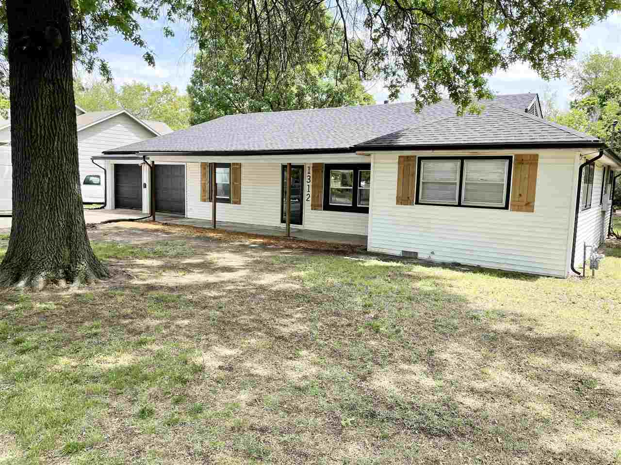 BETTER JUMP ON THIS INDIAN HILLS CHARMER QUICKLY! Zero entry ranch home with new EVERYTHING: Roof, G