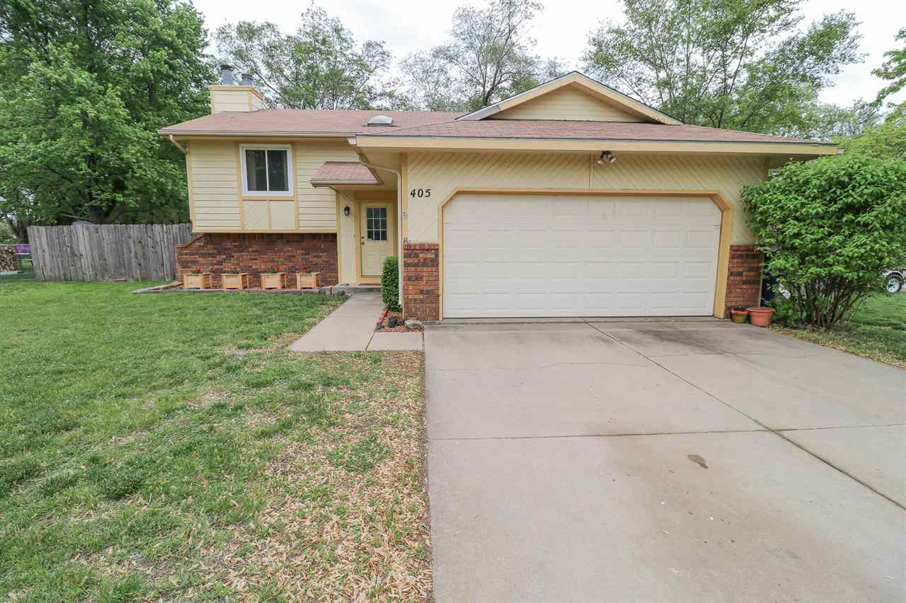 Traditional split-level home located in beautiful Kechi, Kansas.  The sprawling front yard leads to