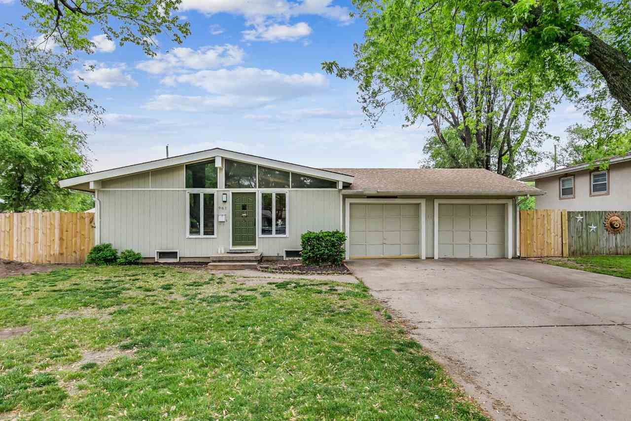 COUNTRY ACRES MID CENTURY RANCH WITH OVERSIZED TWO CAR GARAGE! YOU'RE GREETED BY A SPACIOUS LIVING R