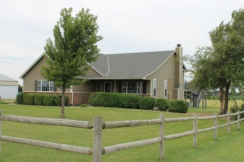 Property Overview - Remarkable location on 5 acres with easy access to Wichita. Beautiful quad-level