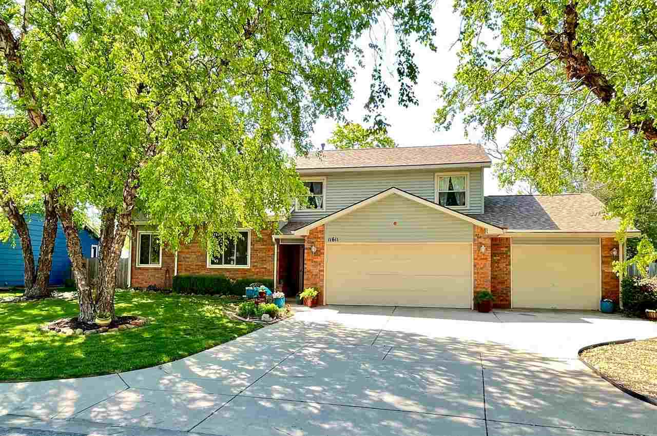 Amazing West Wichita 5 Bedroom 2 1/2 Bath Home with New flooring Throughout the Entire Home Includin