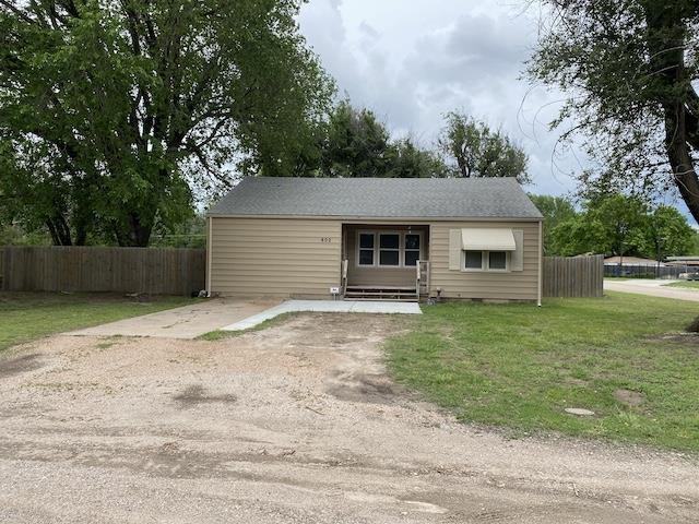 What an adorable home located on a large corner lot in West Wichita! When you arrive you will notice