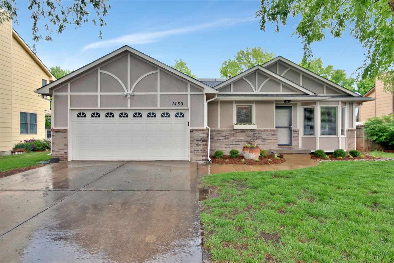 Must see this darling, well maintained 4 bedroom, 2 bath home in Maize School District! You will be welcomed by beautiful REAL hardwood floors. You enter to a beautiful living area, that leads you to the dining area and kitchen with an abundance of counterspace and an eating bar. You will be beckoned to the backyard to enjoy the covered patio and large fenced yard. Upstairs is the master bedroom, a large bathroom and an additional bedroom. Down to the lower level you will enjoy the family room with a fireplace, 2nd bathroom and 3rd bedroom. Down to the basement you will find the 4th bedroom. Everyone has plenty of room to spread out in this home! This home has so much to offer... come see for yourself!!