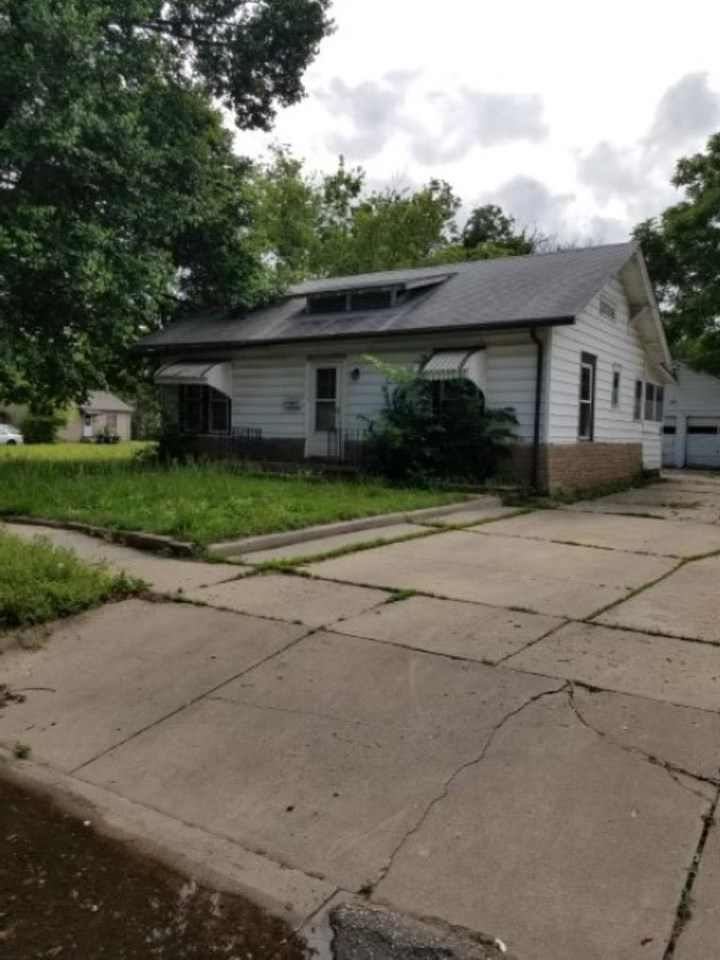 2 bedroom, 1 bath, small basement utility/storage area and detached 2 car garage.  Previously rented