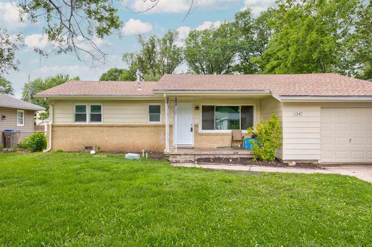 This 3 bedroom, 1 bath, 1 car attached garage home is move in ready. Original hardwood floors and ne