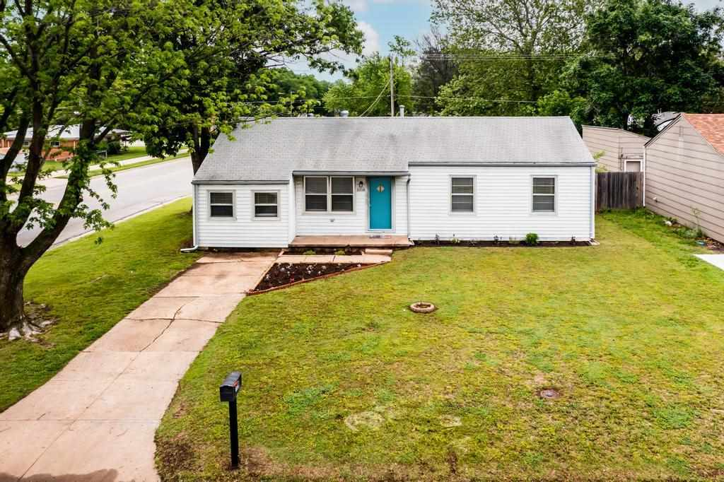 Charming 3 bedroom home located on a corner lot in Derby. Real hardwood flooring throughout most of