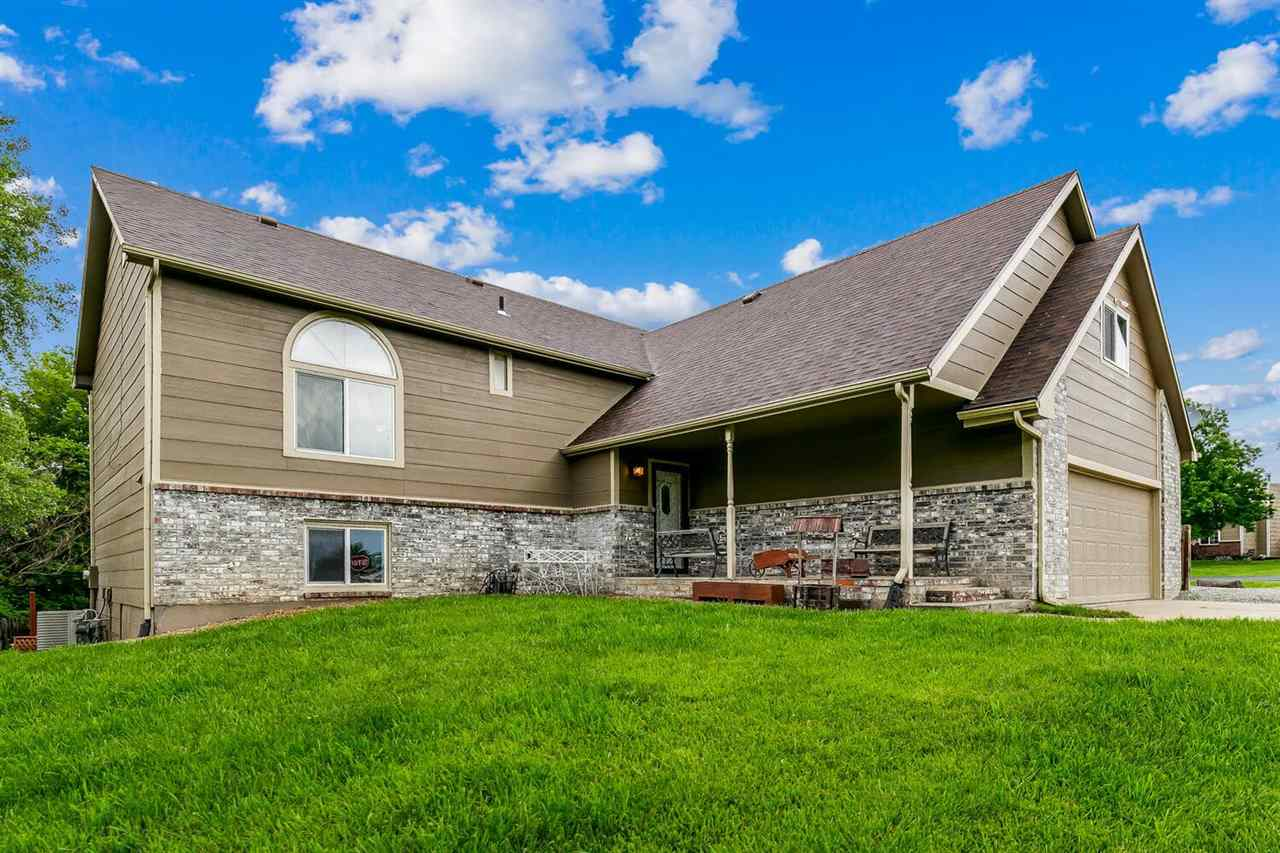 Located on a corner lot in the coveted Woodland Valley neighborhood in Derby. It features plenty of