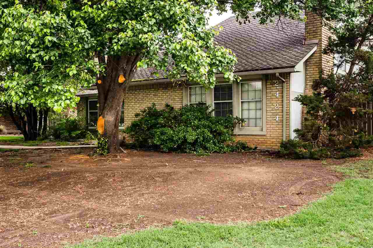 Welcome home to this lovely twin home in North East Wichita. Inside you'll discover a charming livin
