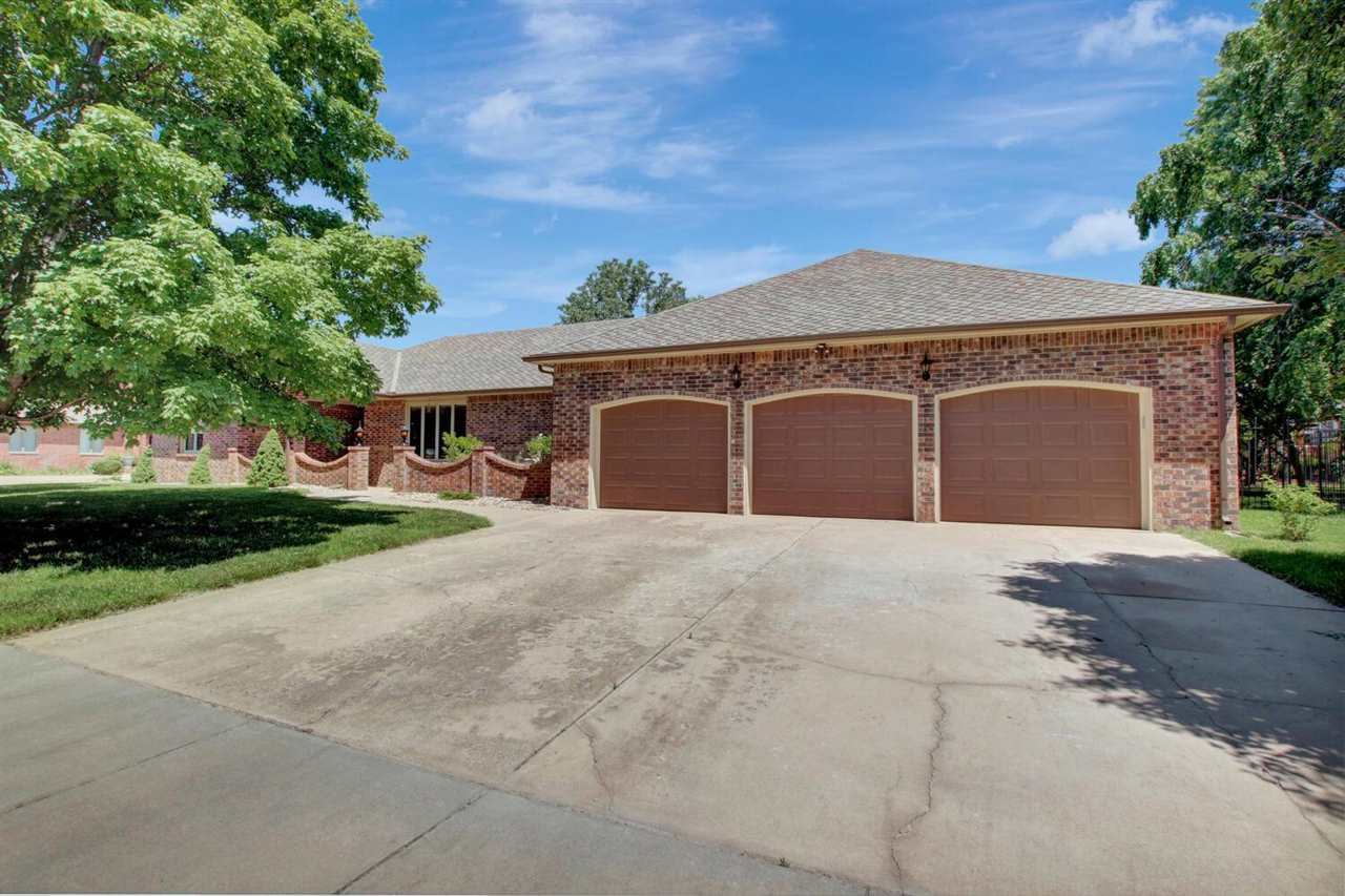 Beautiful, recently updated estate home on a quiet cul-de-sac in established Crestview Country Club Estates. Over 4400 sqft, with 3 bedrooms on the main floor, 2 bedrooms in the basement (1 is nonconforming) 3.5 baths and 3 car attached oversized garage with workshop area. Lots of built-ins and storage. All top of the line appliances stay including large capacity washer and dryer with 3 options for connections in this large home. Crestview country club golf course, pool, and restaurant are just a short walk or golf cart ride away! All of this in highly sought after Andover school district, with lower Sedgwick county taxes and no specials!