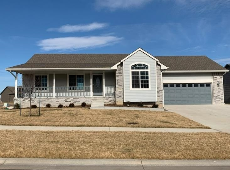 Welcome Home to Derby! Enjoy the summer kicking back on this fabulous front porch or grilling out ba