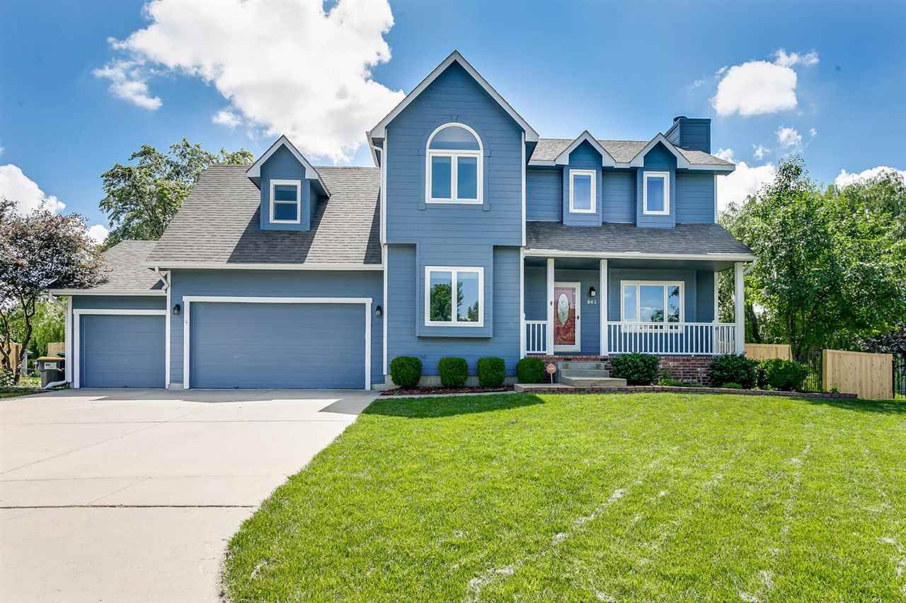 """Featured on 2020 HGTV House Hunters and was """"the"""" chosen home! Majestic 2 story home with 3 car garage and classic timeless appeal at the end of a peaceful cul-de-sac. The sellers have installed beautiful new laminate wood flooring in the living room and formal dining room along with new interior paint throughout the majority of the house. A white brick wood burning fireplace is the focal point of the spacious living room where family and friends can comfortably gather. There is open flow from the living room into the expansive kitchen equipped with appliances that will all remain. You will appreciate the island that provides extra prep space and seating, along with secretly housing your microwave. (island stools will remain) You'll enjoy the expanded living space for relaxing and enjoying the sunsets on your sizeable deck. This home has new large windows allowing an abundance of natural light in the home, with the west windows overlooking your HUGE backyard and new 20x20 shed finished with electrical service. Upstairs is the large master bedroom with a barndoor to the en suite that has 2 sinks, a soaker tub, tiled shower and large walk-in closet. There are 3 more bedrooms, a hall bath with 2 sinks, and you will love the convenience of having a separate laundry room on the same floor as your bedrooms! The basement offers a second living space with view out windows, wet bar, bedroom, full bath and storage. Don't miss the newly installed solar panels that will reduce your energy bills. The exterior of the home and the deck were just painted, new vinyl flooring in main floor powder bath and basement bath, new low gallon usage toilets, new front and side fencing, new front landscaping, new dishwasher, above cabinet lighting in kitchen, new dining room chandelier, WOW! This is a wonderful home in a desirable neighborhood that offers many amenities for its residents. Truly, a great home for you!"""