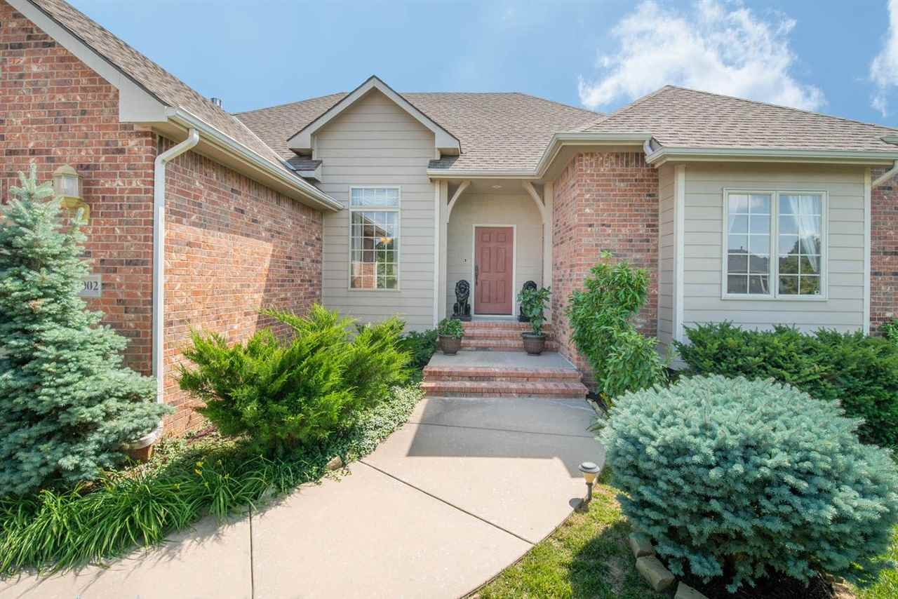 1 OWNER FORMER MODEL PATIO HOME IN THE HIGHLY DESIRED WILSON ESTATES BRIGHTON COURTS! THIS HOME IS I