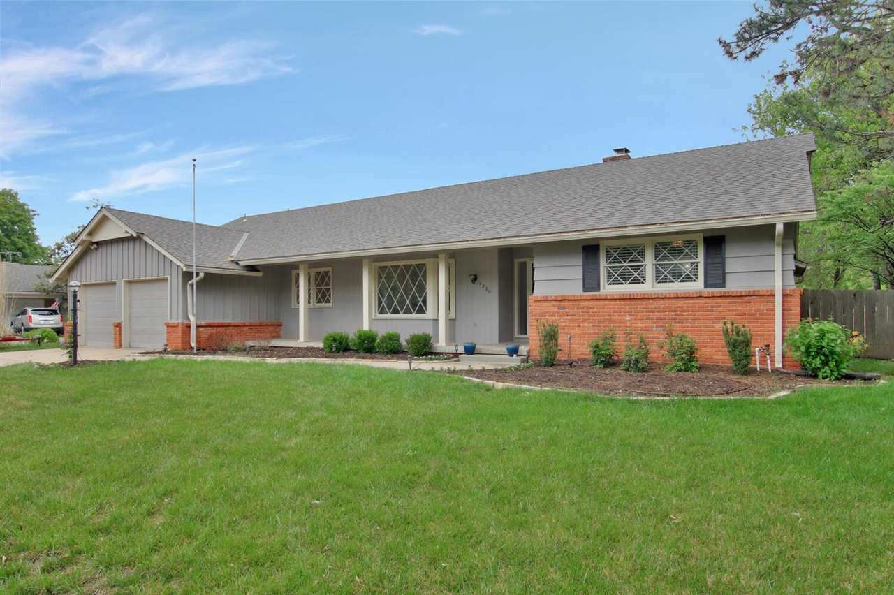 You will love coming home to this stunning completely remodeled sprawling ranch situated on a beauti
