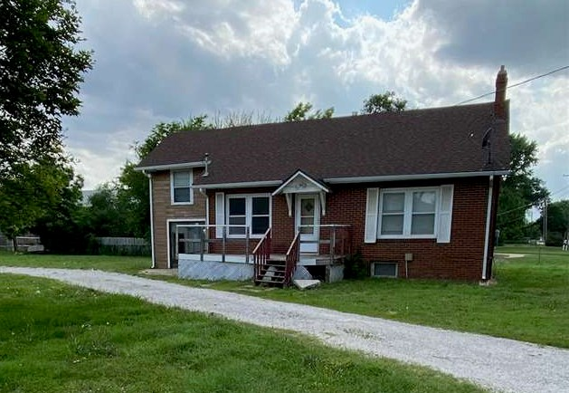 Great investment opportunity.  With over 2100 sq feet of living space and a half acre lot, the possi