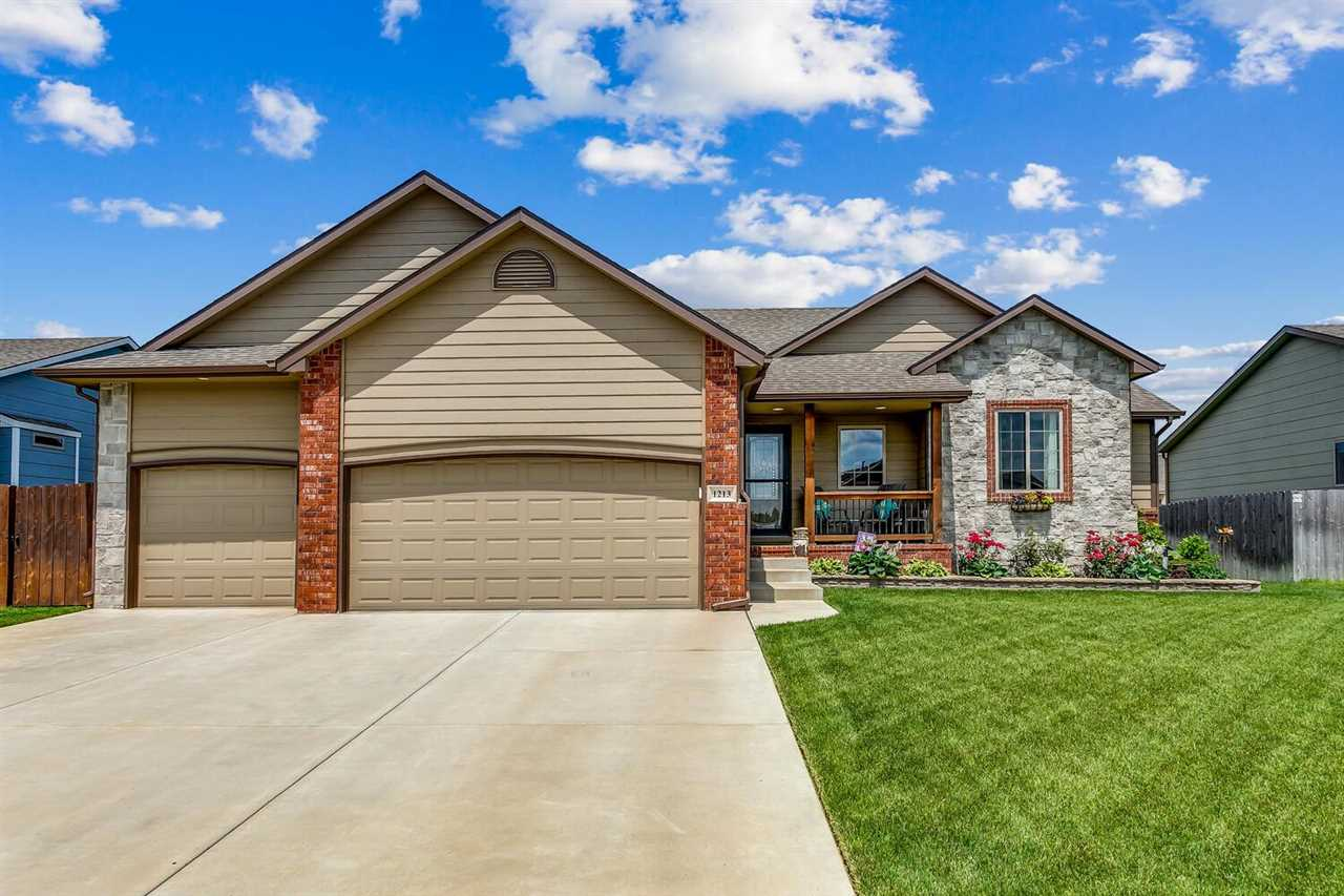 THIS ATTRACTIVE DERBY HOME HAS SO MUCH TO OFFER! VAULTED CEILINGS, ARCHED DOORWAYS,  AND ABUNDANT WI