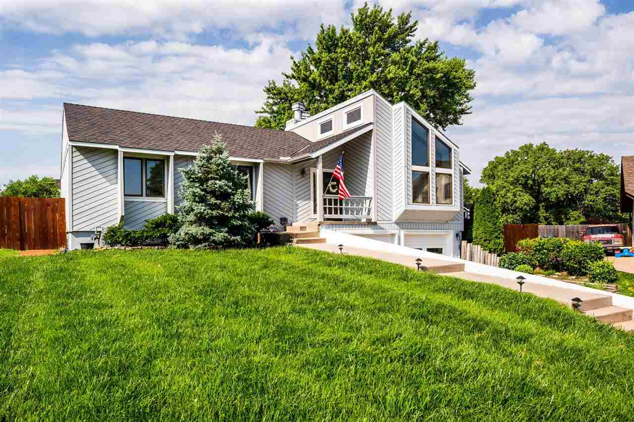 Immaculately maintained ranch situated on a beautiful cul-de-sac lot with water views and complete w