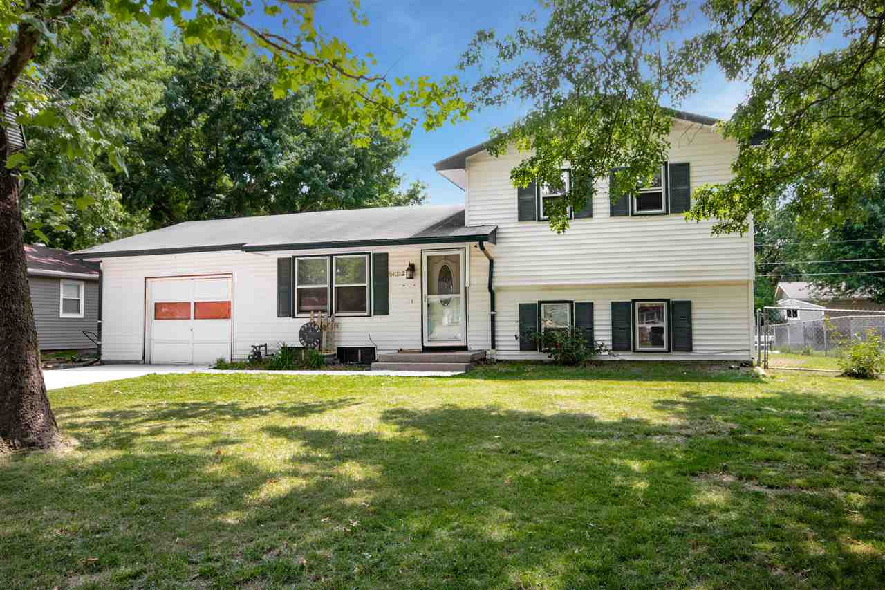Beautifully shaded by mature Sycamore and Oak trees. This 4 bedroom, 2 bathroom, 1 car attached gara