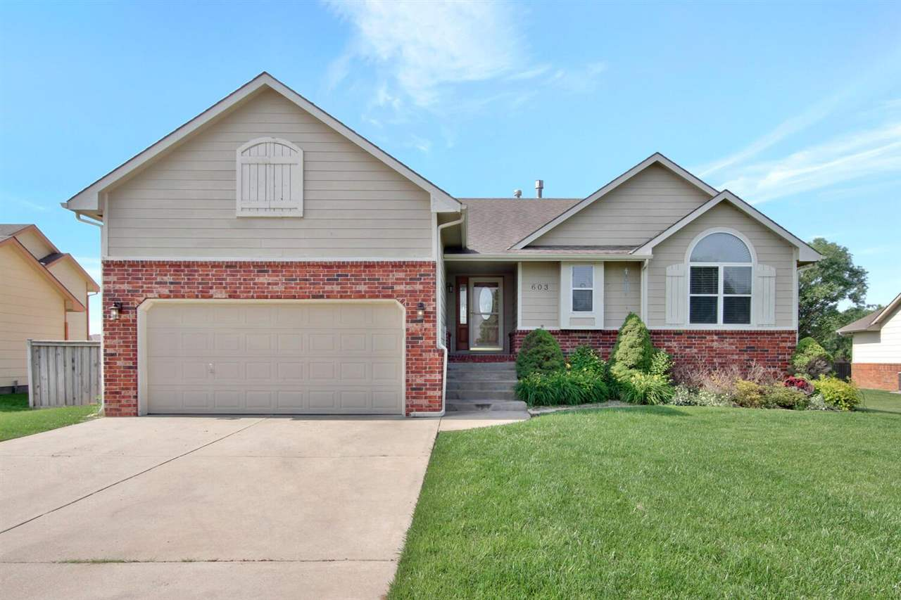 Welcome home! This beautiful 4 bedroom, 3 bathroom, ranch style home has an awesome mid-level walk-o