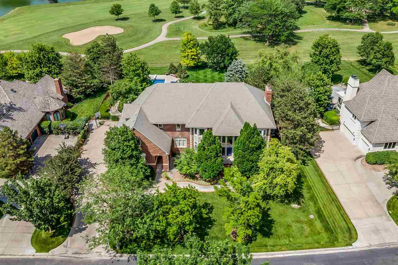 This beautiful home sits on a panoramic golf course view at Crestview Country Club!  A stately brick