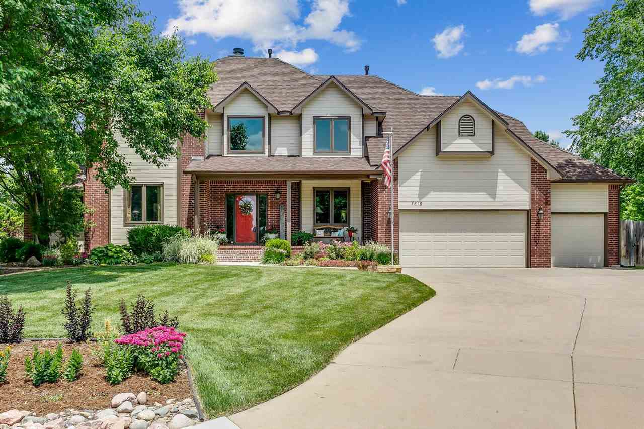Located at the end of a cul de sac on a nearly half acre lot, this two story, impeccably maintained