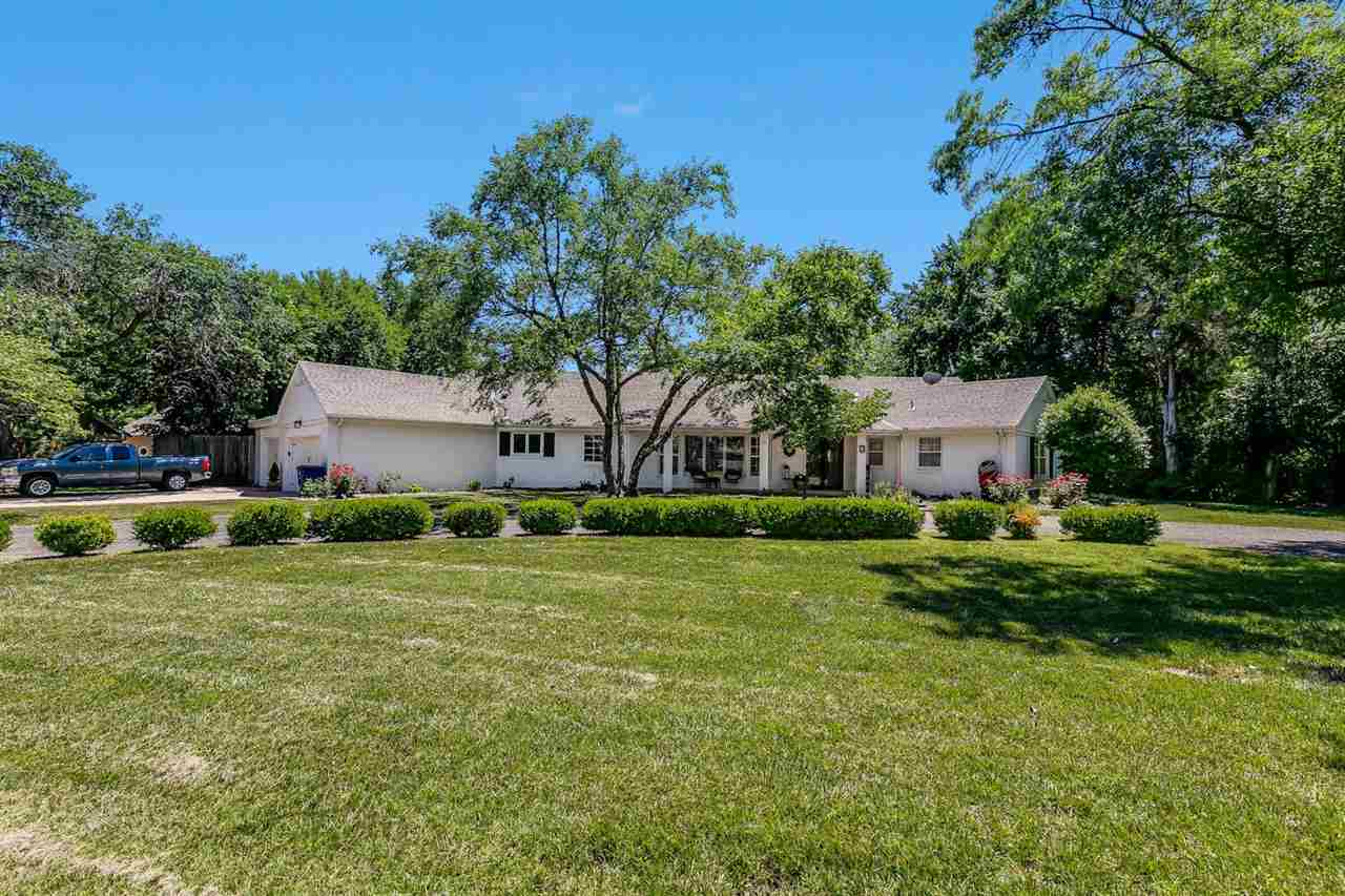 Location! Location! This Eastborough Home has been updated and is move in-ready. The open floorplan