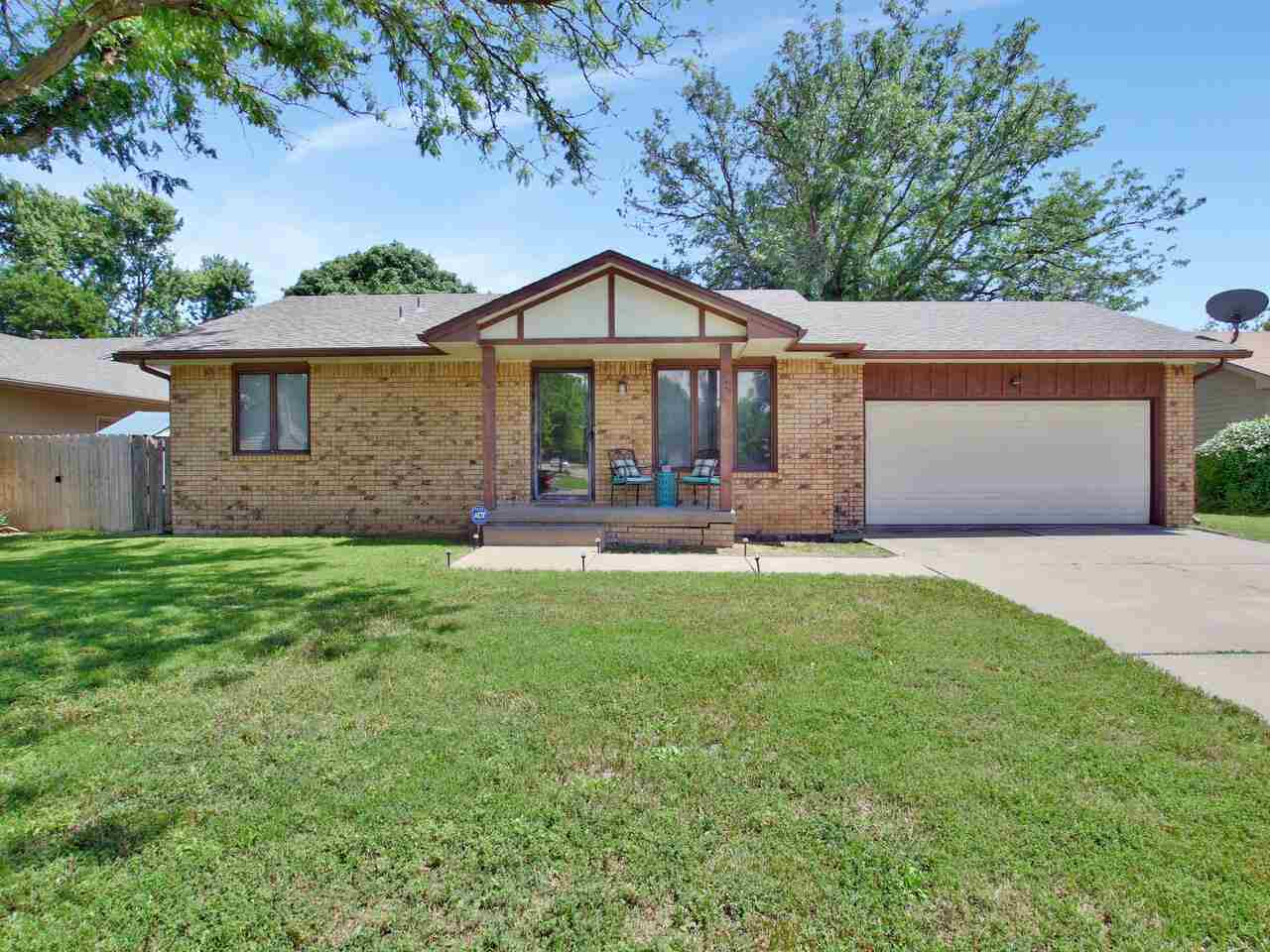Move in ready 2 bedroom, 1 bath home in Bel Aire with a full basement and oversized 2 car garage. Ex