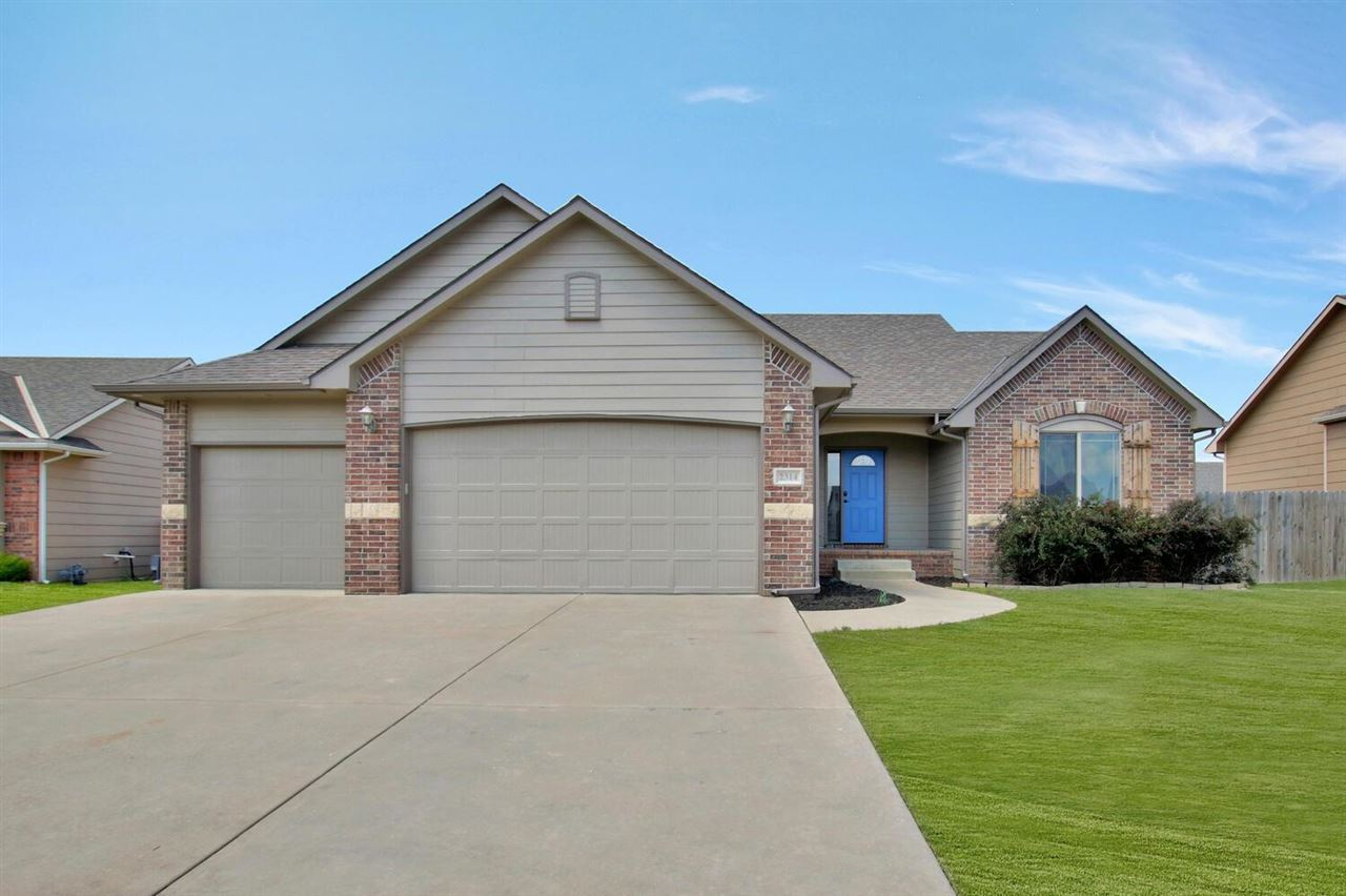 Beautiful split floor plan home with all the perks! The large main floor living room is partially op