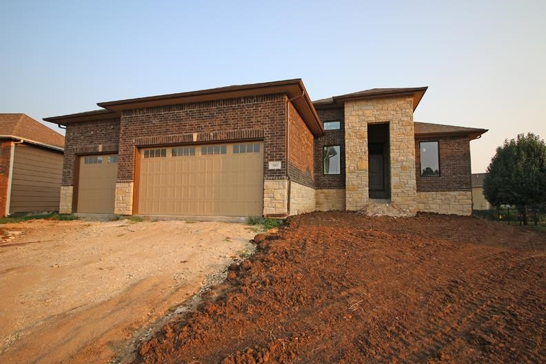 New home under construction with NO SPECIALS and ready for your final touches.  The cabinets and cou