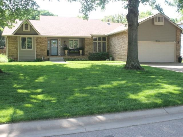 Come take a look at this Northwest Wichita charmer! Great curb appeal with mature trees and situated