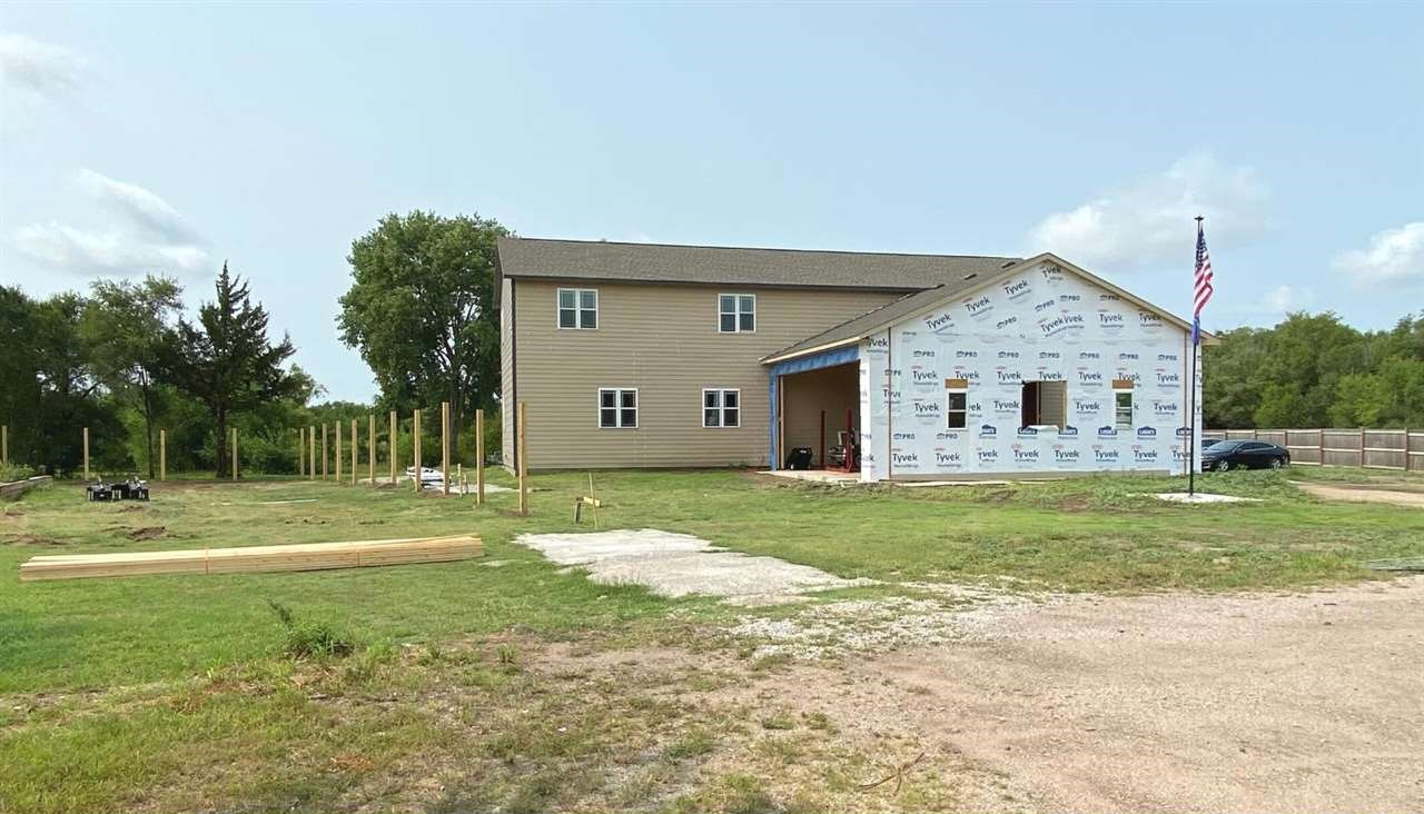 Brand new home situated on almost an acre wooded lot at the end of a cul-de-sac that features a grea