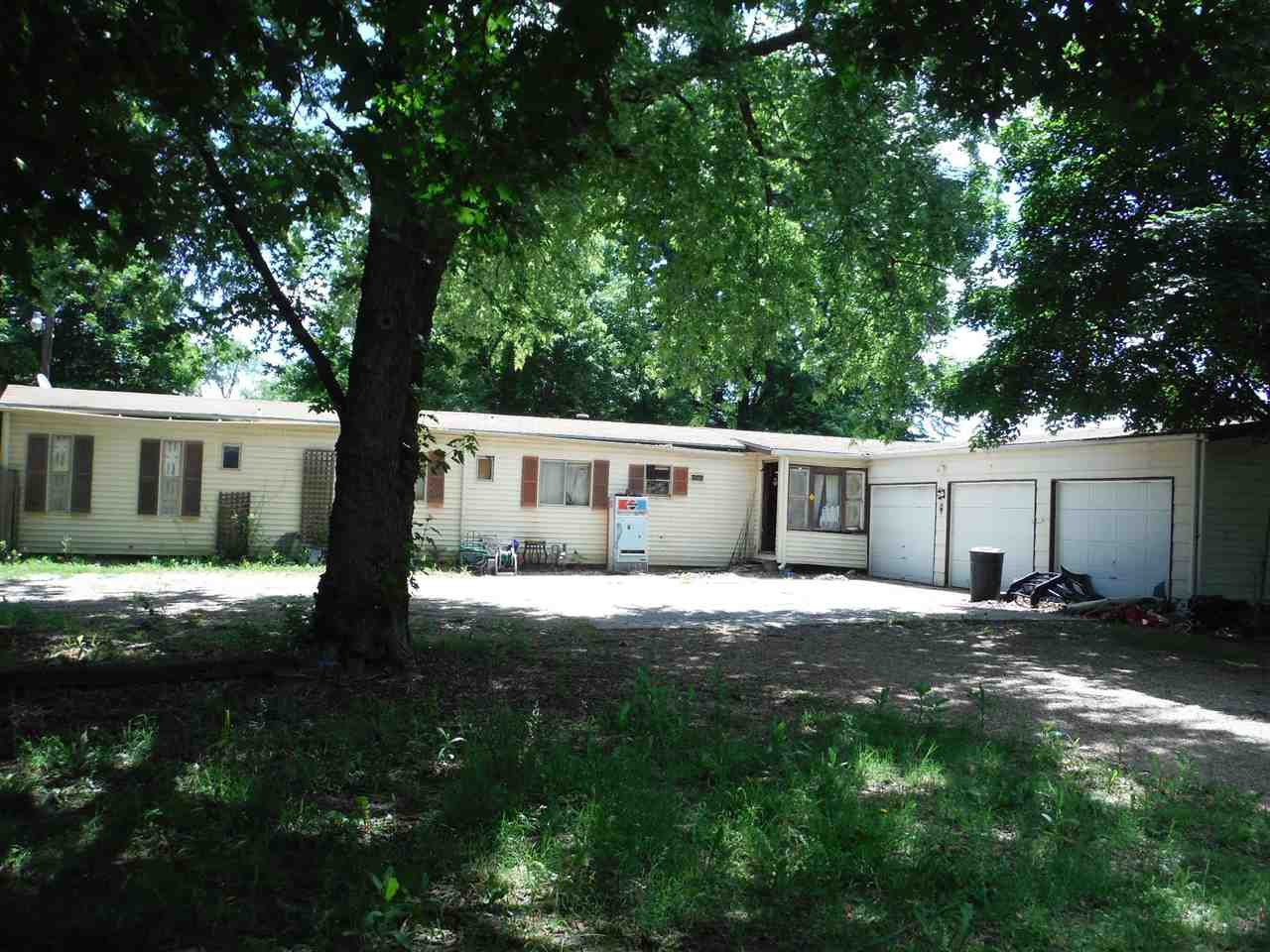 Single mobile home with a full basement and an attached 3-car garage with over an acre of land. Full
