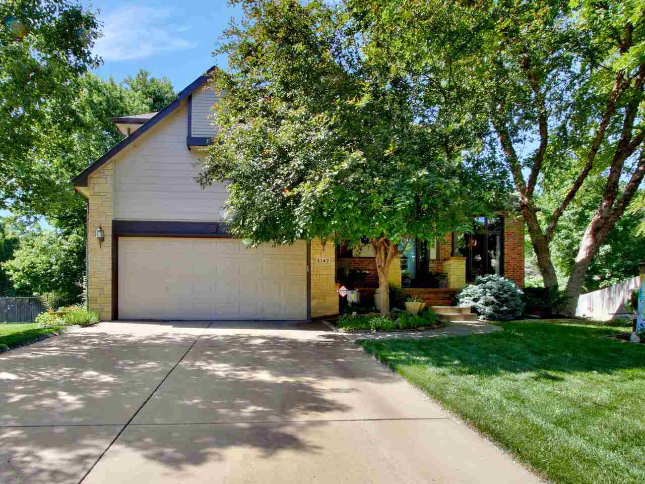 BEAUTIFUL cul de sac location with phenomenal landscape curated by a master gardener * Open floor pl