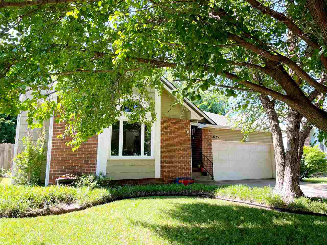 This home greets you with terrific curb appeal and mature trees. The main floor offers a living room