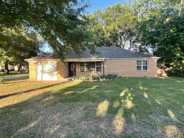 Welcome to your country home - on paved frontage and close to everything. Full brick ranch with 3 be