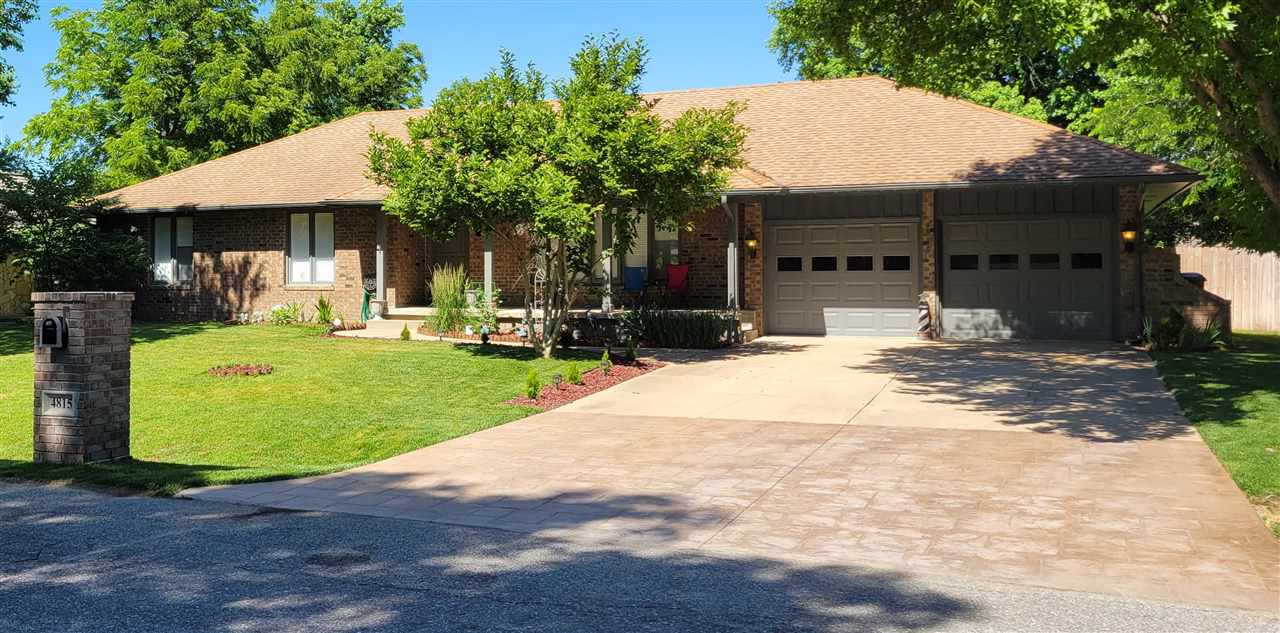 Beautiful sprawling brick ranch in a quiet neighborhood north of Wichita. The attention to detail in